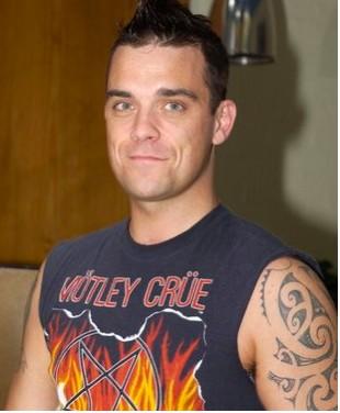 Robbie Williams prepara regreso a la música